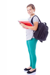 Full body portrait of a school girl with backpack holding notebo