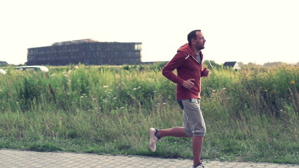 Jogger running in countryside, super slow motion