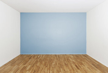 Empty room with a blue wall