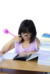 Portrait of cheerful Asian young girl doing her homework