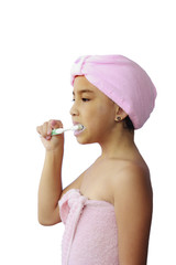 Little asian Girl brushing her teeth, Isolated on white