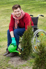 Capable disabled watering flowers
