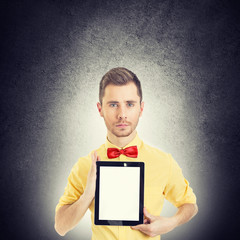 Hipster geek man with red bow tie showing tablet