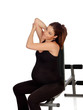 Pregnant woman stretching in the gym