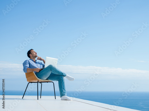 canvas print picture relaxed young man at home on balcony
