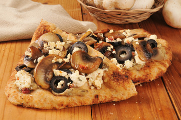 Naan bread with mushrooms and feta cheese