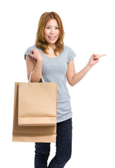 Woman with paper bag and finger point out