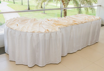 Table decorated with white table cloth.