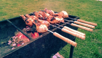 Outdoor summer barbeque, grilled chicken legs
