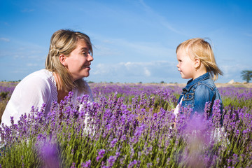 Little girl with her mother in lavender field