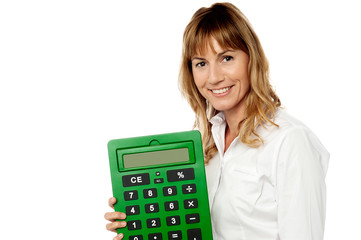 Smiling woman showing big calculator