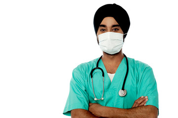 Young male doctor with face mask