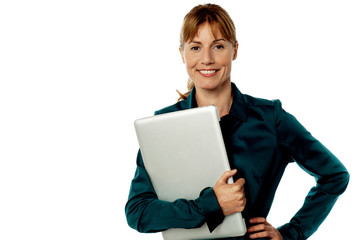 Smiling secretary holding laptop