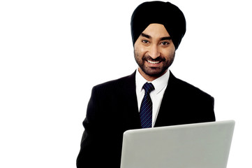 Happy businessman using is laptop computer