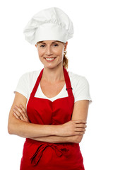 Female chef posing with folded arms