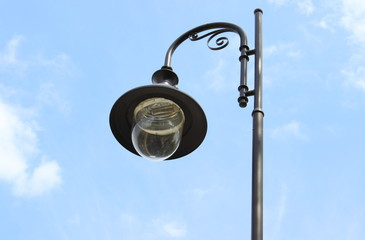 Park lamp on blue sky background