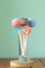 Variety of colorful cake pops - chocolate, vanilla and caramel