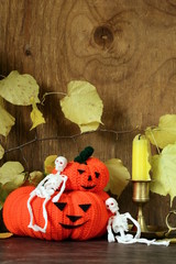 Halloween still life - pumpkin with  yellow leaves