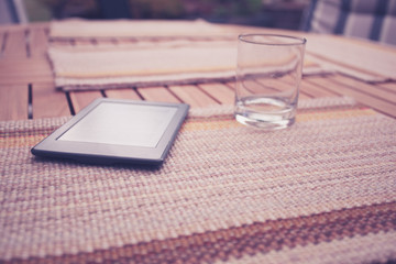 Tablet and empty glass