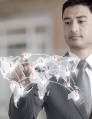 Young Businessman Pointing on Map