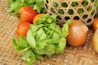 Vegetables salad and tomato in the basket