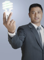 Man holding CFL light.