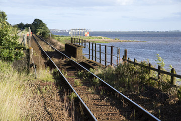 Railway track running alongside River Exe Devon England UK