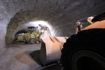big machinery in a dark mine