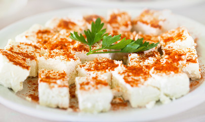 Original bulgarian cheese into plate with parsley and red hot pe