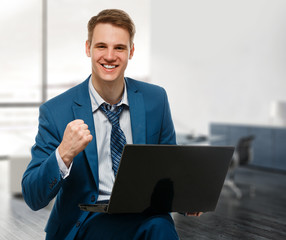 Businessman with computer in office