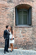 Loving young couple outside an old brick building