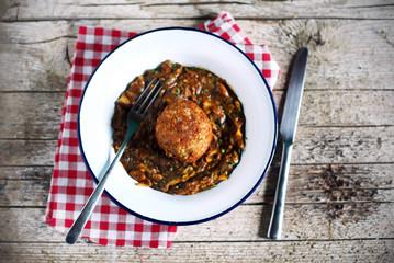 Arancini stuffed italian rice balls with forest mushroom ragout