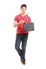 Young filmmaker holding a movie-clapper