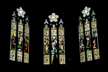 Three Stained Glass Windows on Black