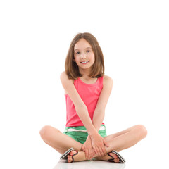 Cheerful girl sitting with legs crossed