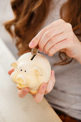 Money, finance. Girl with piggy