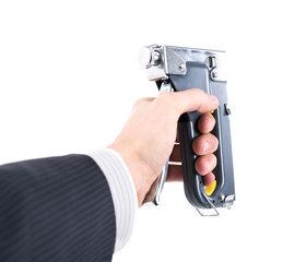 staple gun in hand on a white background