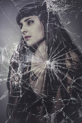 broken glass, beautiful brunette woman with very long hair
