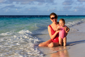 mother and little daughter on sea vacation