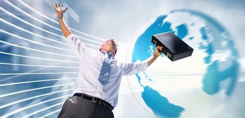 Composite image of businessman holding briefcase and cheering