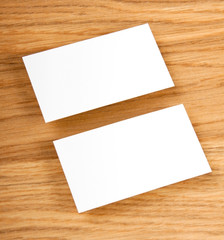 blank business cards on a wooden background