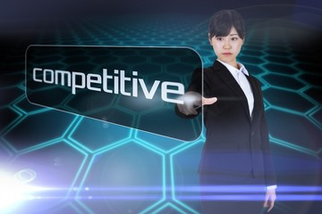 Businesswoman pointing to word competitive