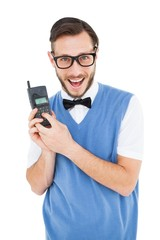 Geeky hipster holding a retro cellphone