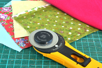 rotary knife and pieces of cloth for patchwork