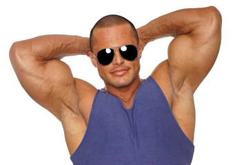 Muscular man in undershirt poses with hand over the head