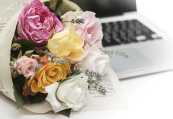 Bouquet of roses on notebook