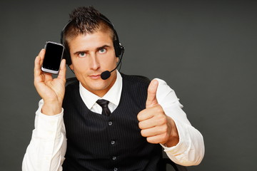 Young man service operator shows on mobile phone