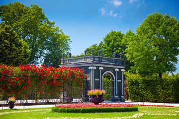 pavilion and a path made of roses