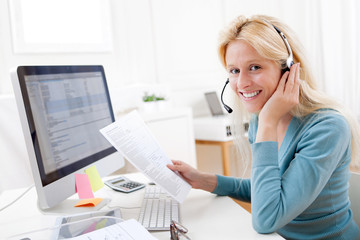 Young attractive blonde working in a call center