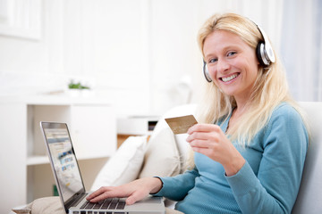 Attractive blonde woman shopping online